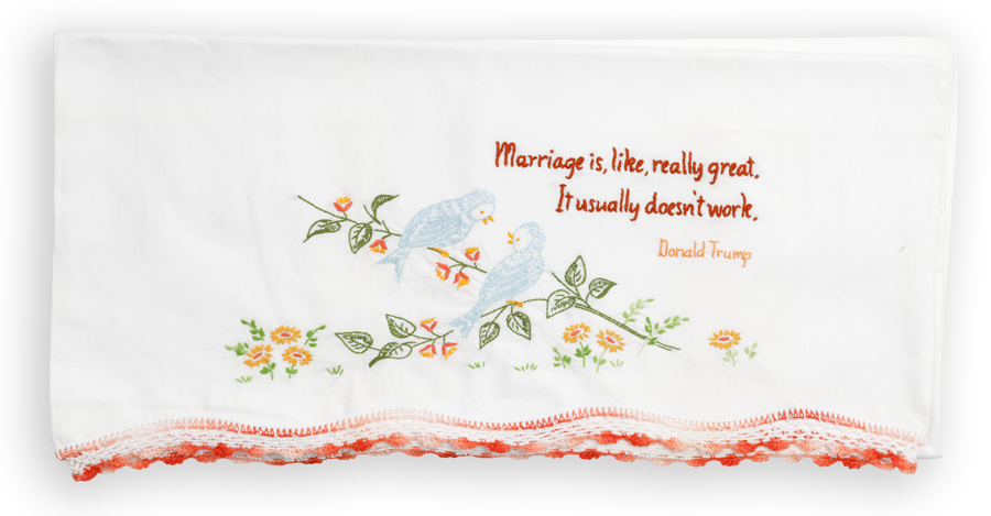 """A embroidered pillowcase, with a quote by Donald Trump, that reads: """"Marriage is, like, really great. It usually doesn't work."""""""
