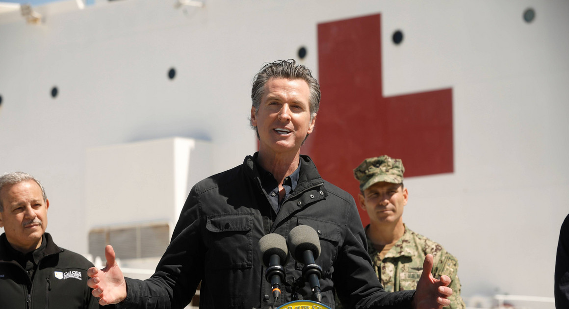 California Governor Gavin Newsom speaks in front of the hospital ship US Naval Ship Mercy. | AP Photo