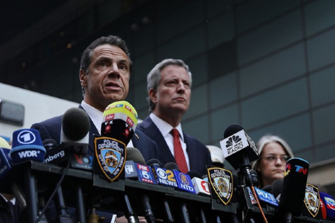 Andrew Cuomo and Bill de Blasio speak at a news conference | Getty Images