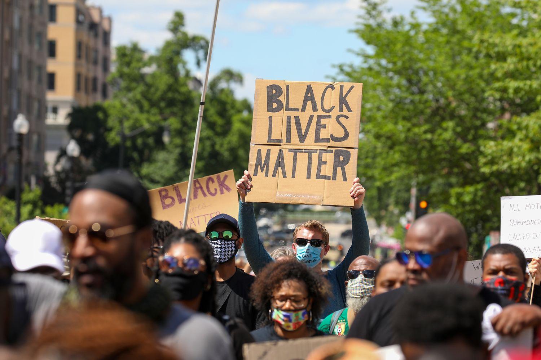 A protester holds a Black Lives Matter sign