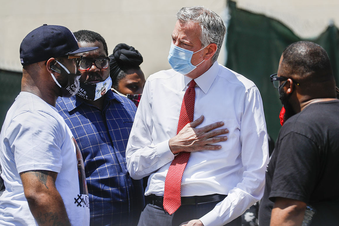 Terrence Floyd, brother of the deceased George Floyd, speaks with New York City Mayor Bill de Blasio during a rally at Cadman Plaza Park.   AP Photo